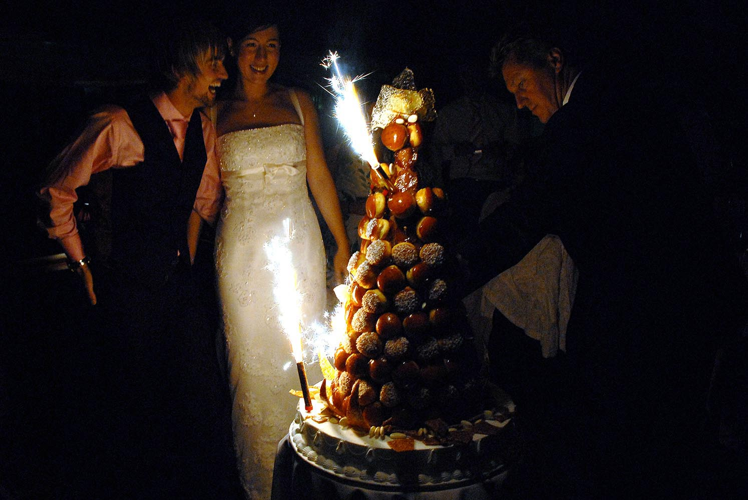 Bride and groom enjoying wedding cake