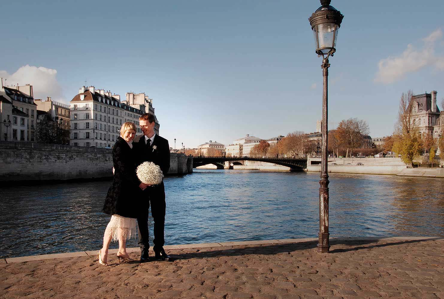 Bride and groom on Seine side, Paris, France