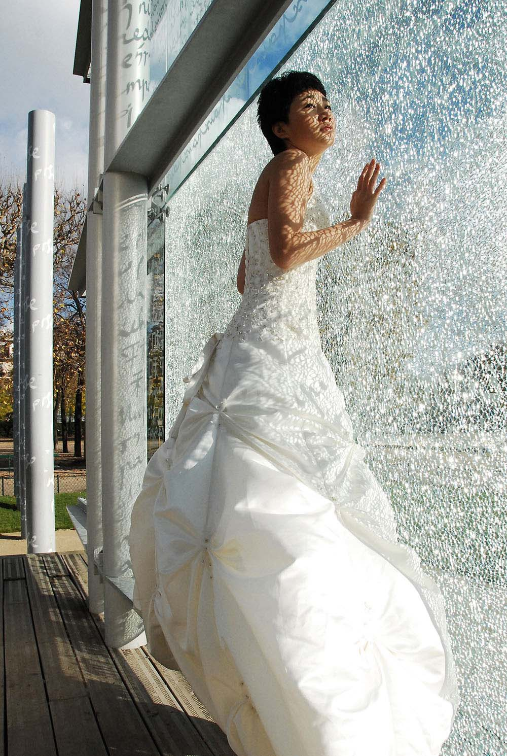 Bride in white dress in front of Peace Memorial monument, Paris, France