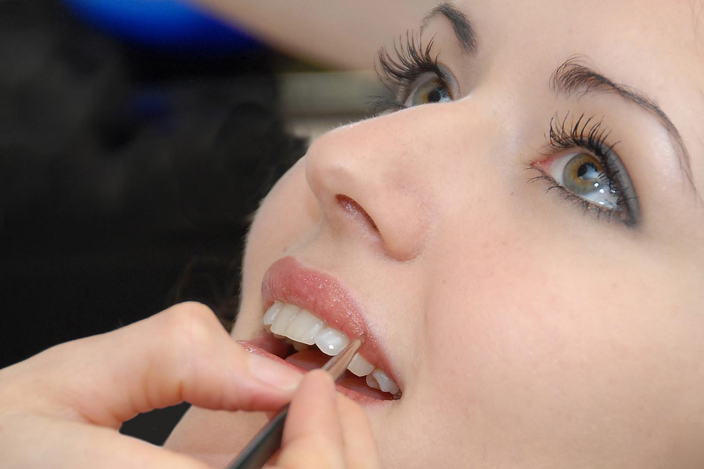 Close up of pretty bride getting lipstick makeup