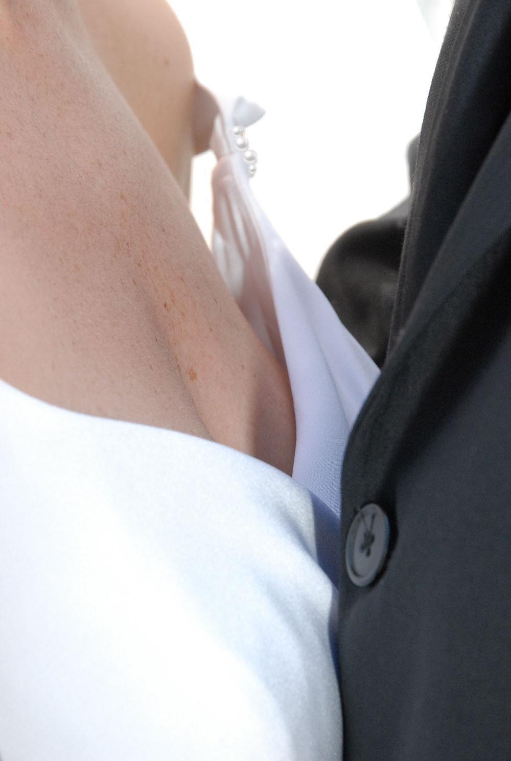 Close up of married couple, breast height, dress detail