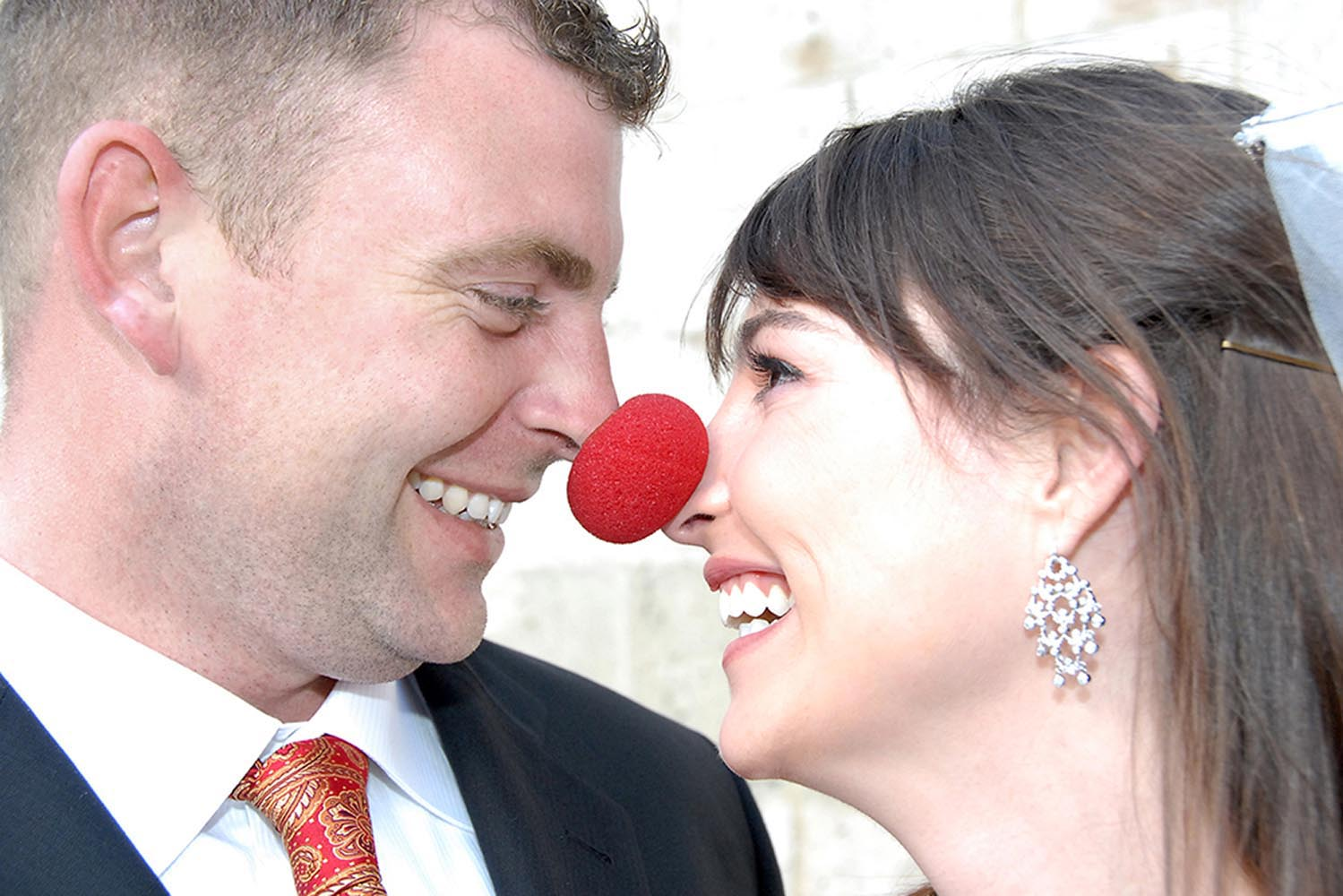 Close-up portrait of bride and groom with clown's nose