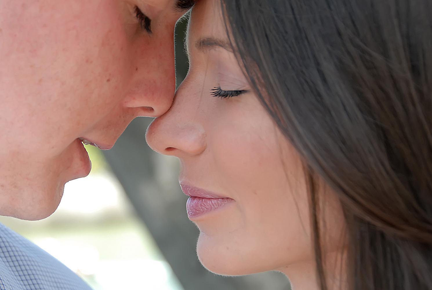 Close-up portrait of newly weds, nose to nose