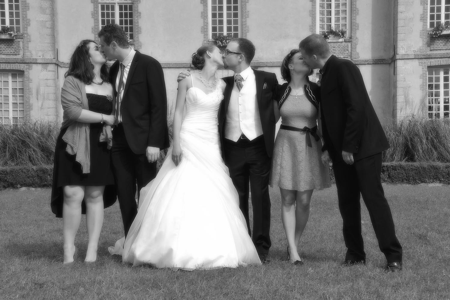 Three couples kissing each other at wedding