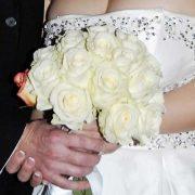 Testimonials Illustration of bride and groom holding wedding bouquet