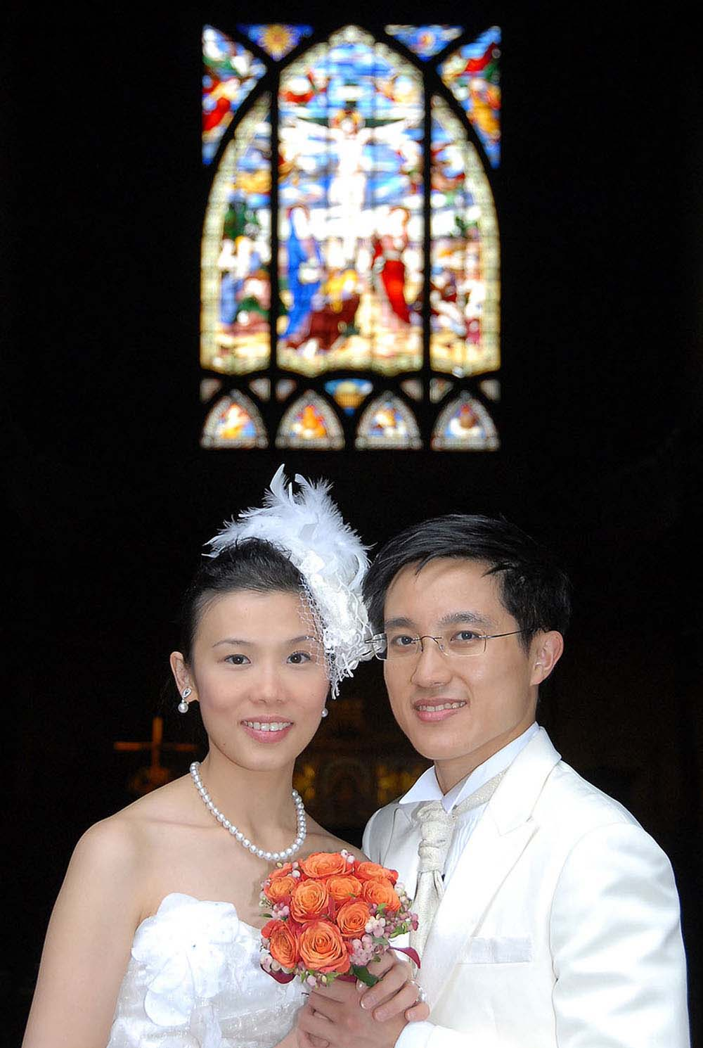 Married couple from Hong Kong at church, Paris, France