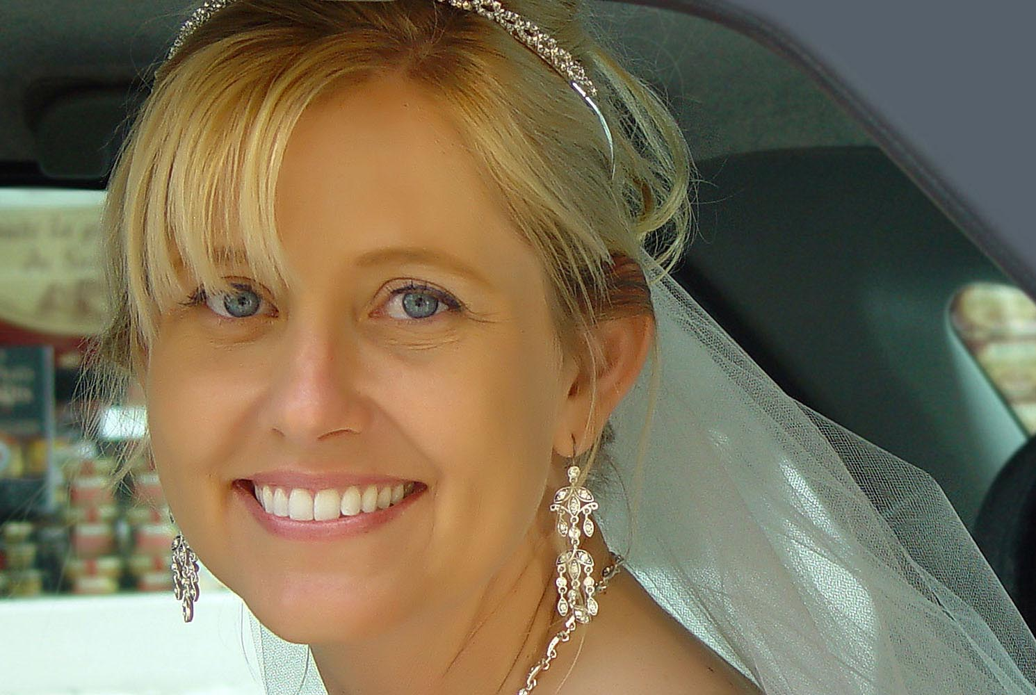 Portrait of bride with diamonds, photographed in car