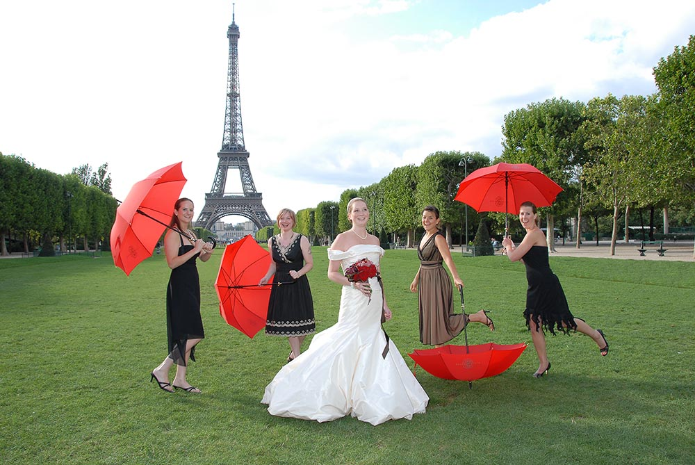 Photo after touching up of wedding with bride and guests, Eiffel Tower gardens, Paris, France