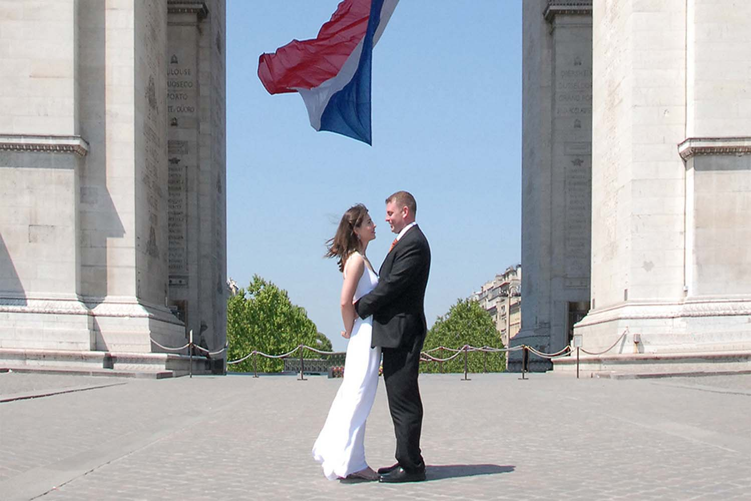 Wedding Couple in front of the Arc de Triomphe, Champs Elysees, Paris, France