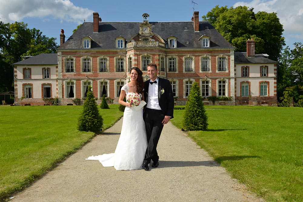 Photo after touching up of wedding couple in front of castle at Saint-Leger-de-Rotes, France