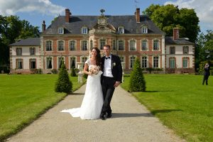 Photo before touching up of wedding couple in front of castle at Saint-Leger-de-Rotes, France