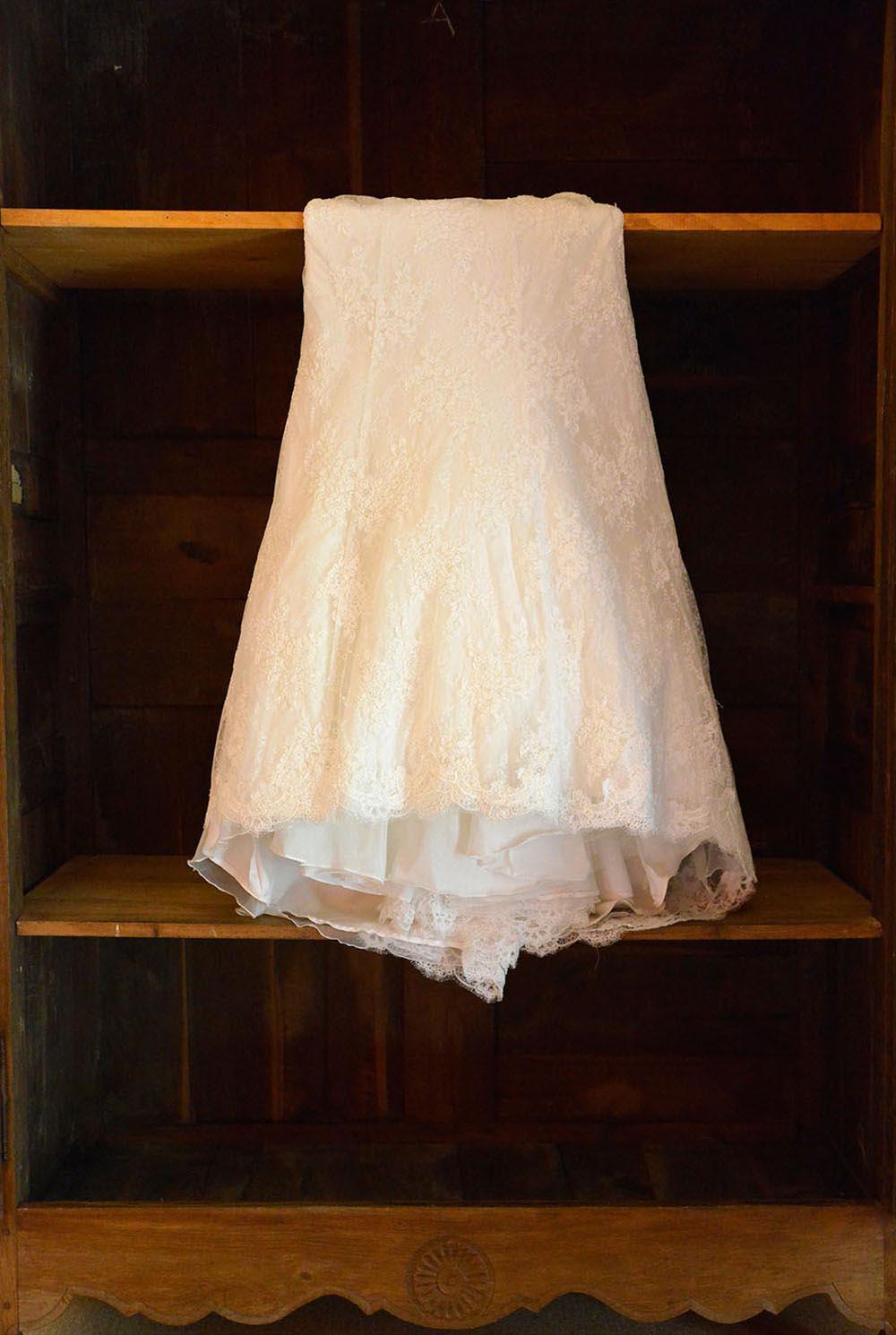 Wedding dress hanging on cupboard