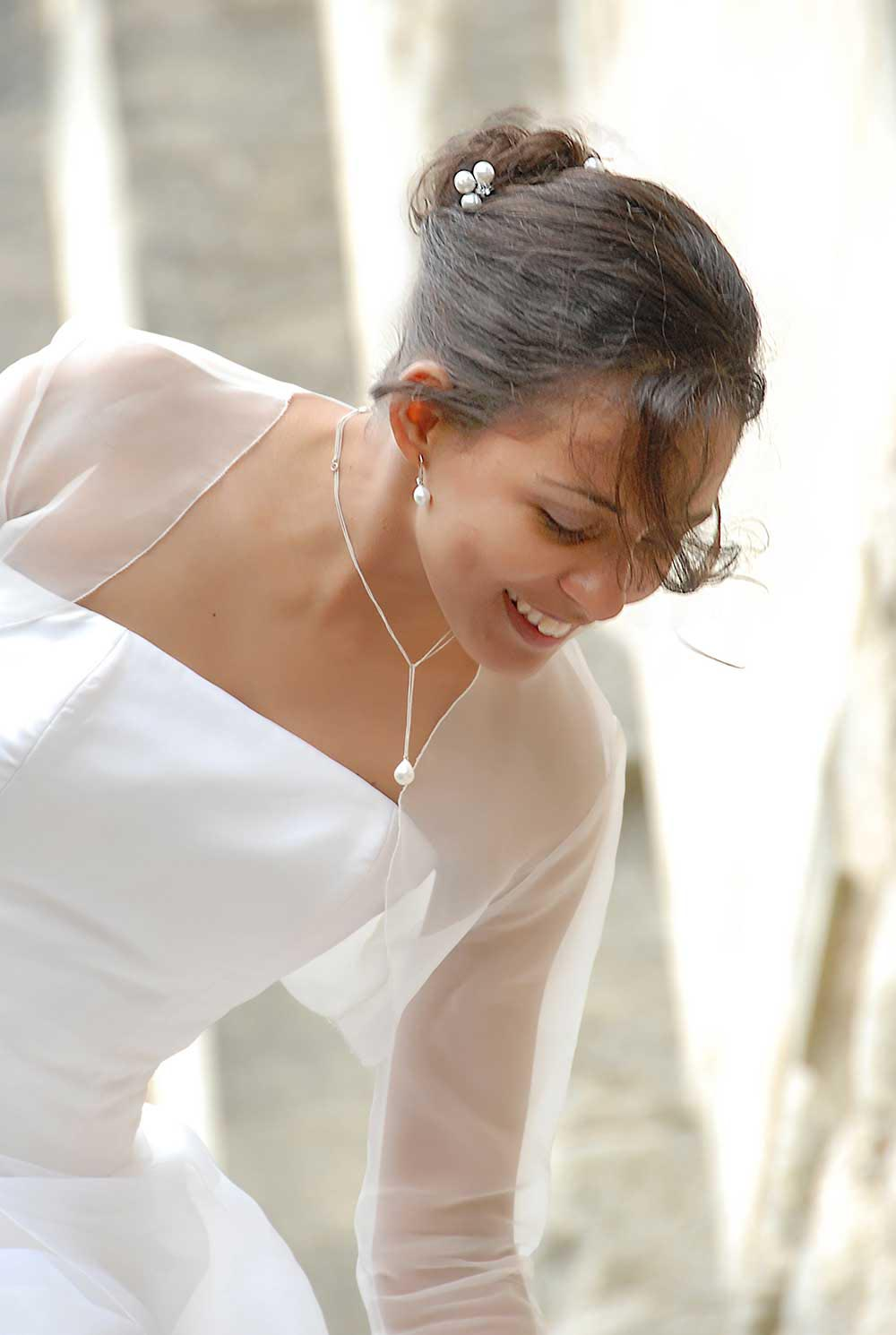 Bride in wedding dress with pearl necklace