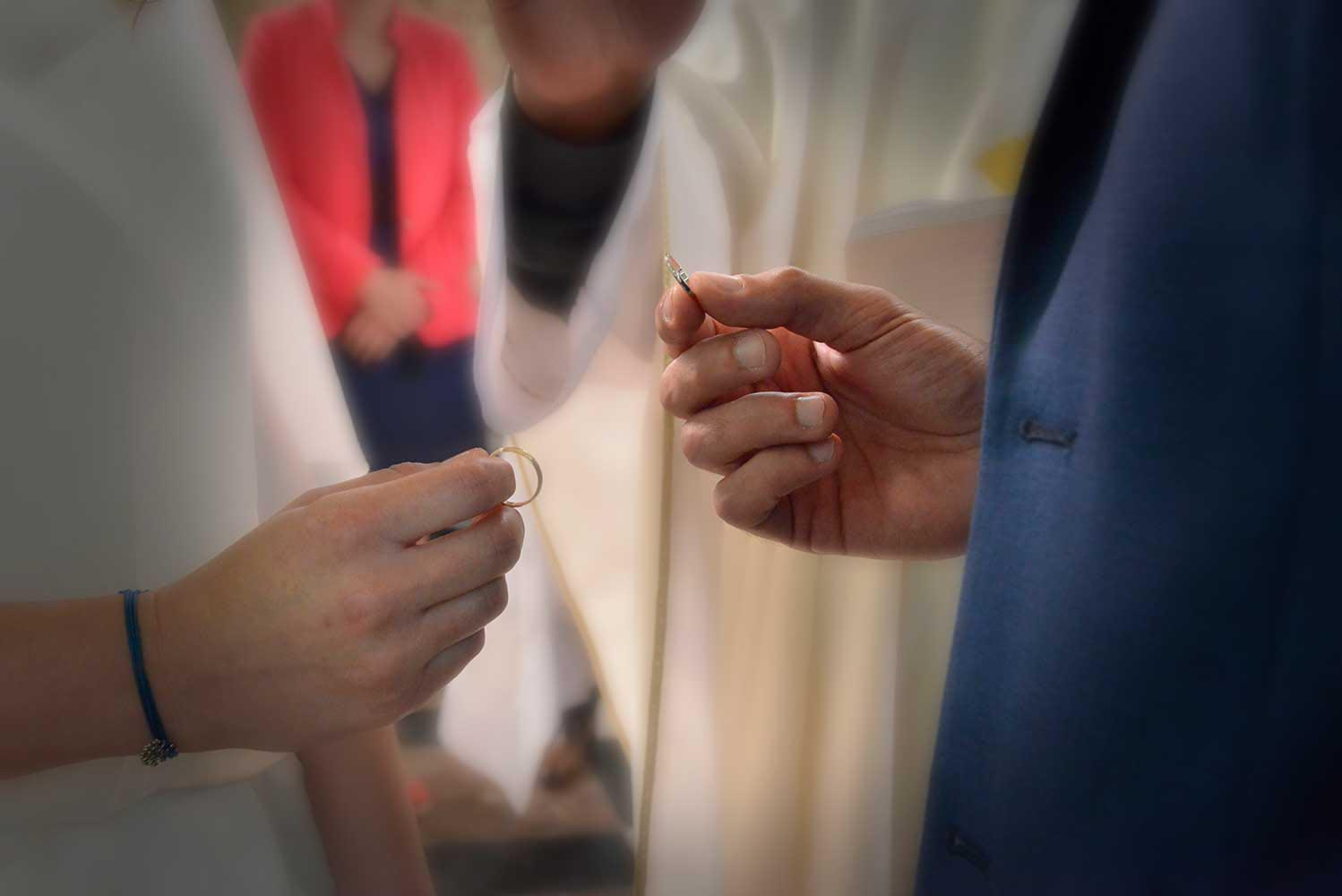 Wedding ring exchange during church ceremony
