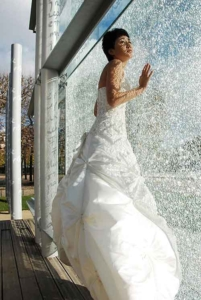 Bride in white dress. Wedding in front of Peace Memorial monument, Paris, France