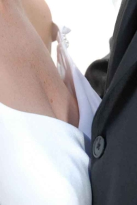 Close up of married couple, breast height, showing dress details