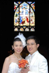 Wedding couple from Hong Kong at church, Paris, France