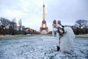 Married couple with snow and Eiffel Tower, Paris, France