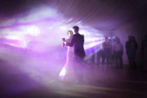 Wedding couple opening dance with smoke and violet lighting