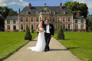 Wedding couple in front of castle, Saint-Leger-de-Rotes, France