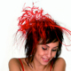 Woman wearing a fascinator at a wedding